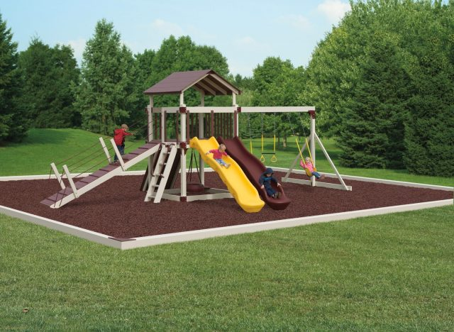 Busy base camp vinyl swingset made safer with rubber mulch