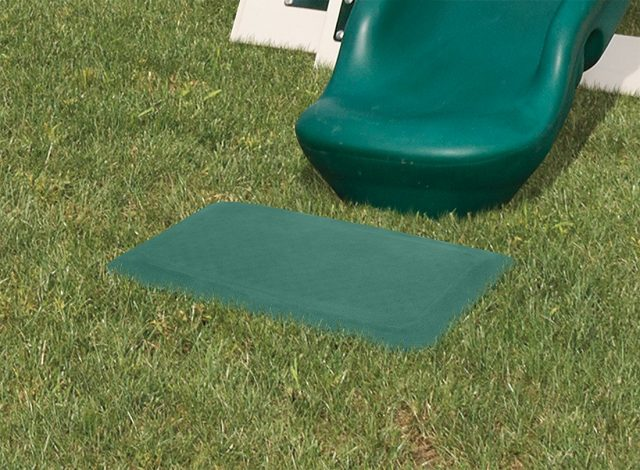 Rubber mat along with a slide and swing set from Advneture World Playsets.