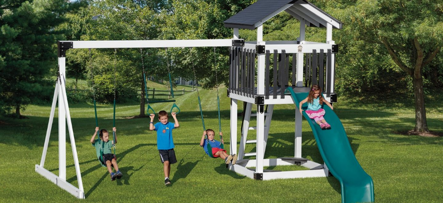 Children enjoying an authentic amish-made swing set from Adventure World Playsets
