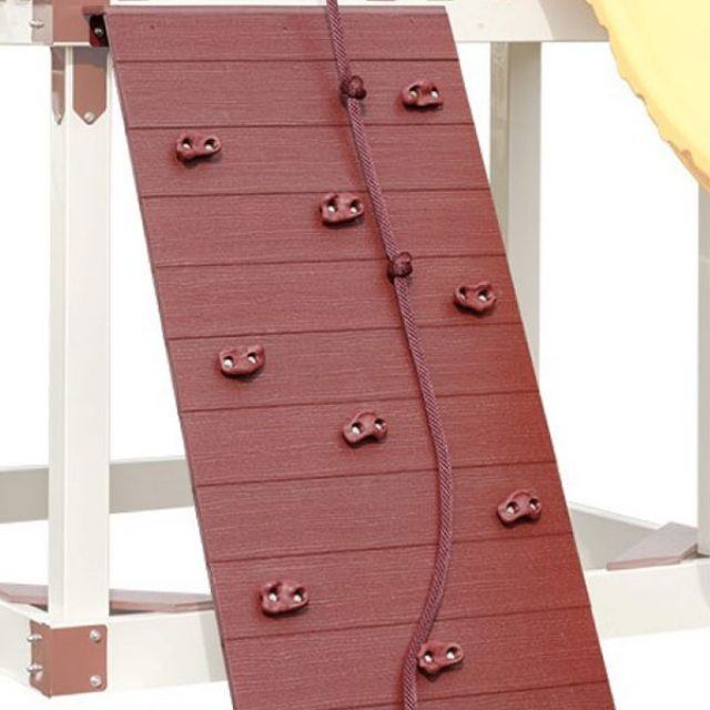 mini rock wall on swing set for children six years and older
