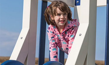 girl outside playing an imagination game like hide-and-seek