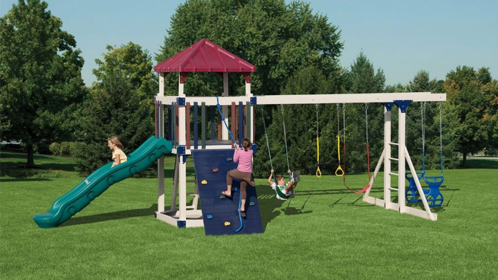 kids playing on swing set after a quality inspection