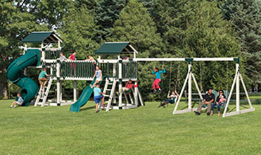 family playing outside on swing set
