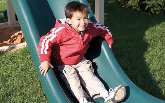 boy on playset during the winter