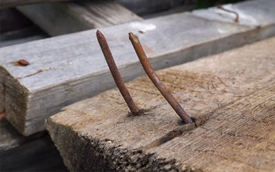 rusty nails on wood swing set