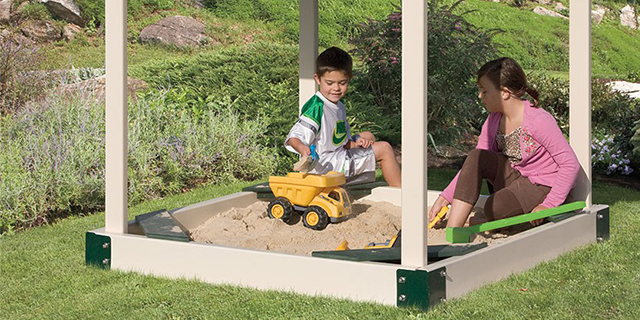 sandbox next to outdoor play set