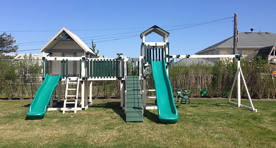 swing set with a play house