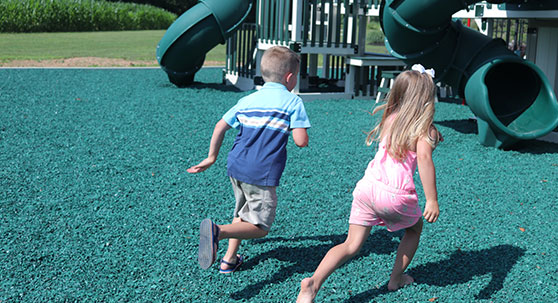 best material for playground surfaces